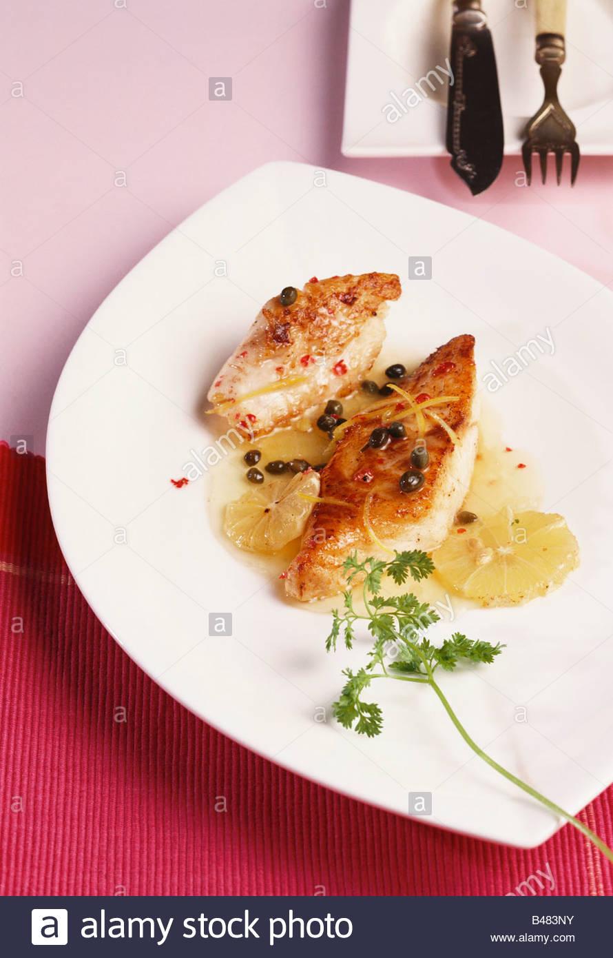 Filete de pescado con limón Imagen De Stock