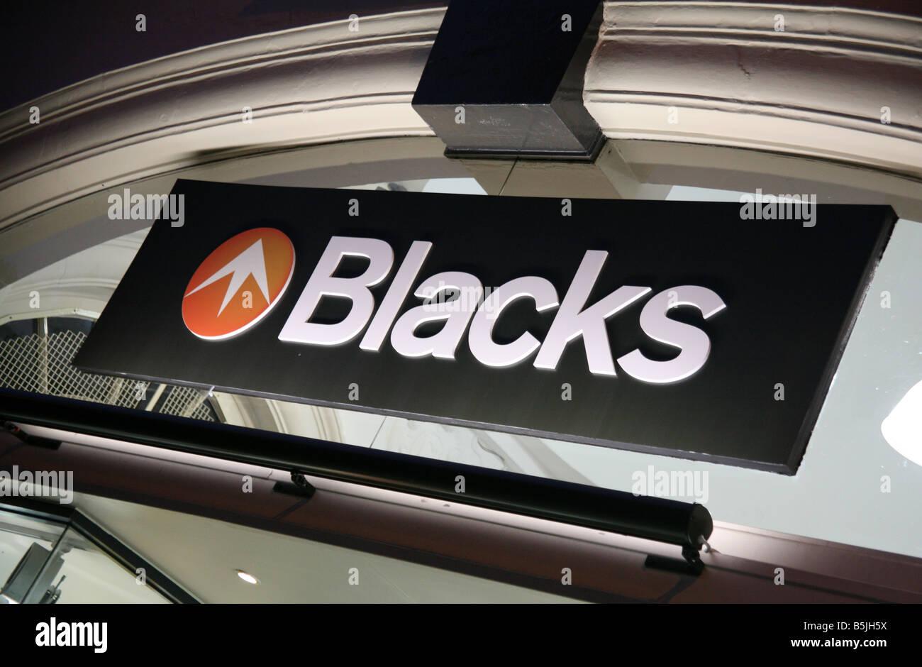 Firmar en la rama de los negros al aire libre de Londres tienda de desgaste Imagen De Stock