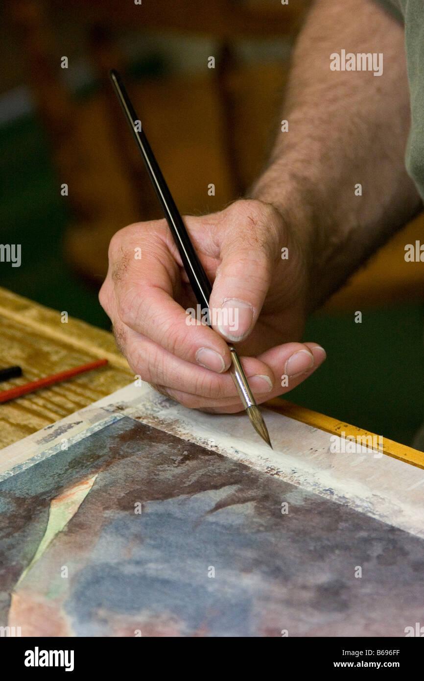 Acuarela artista en el trabajo Imagen De Stock