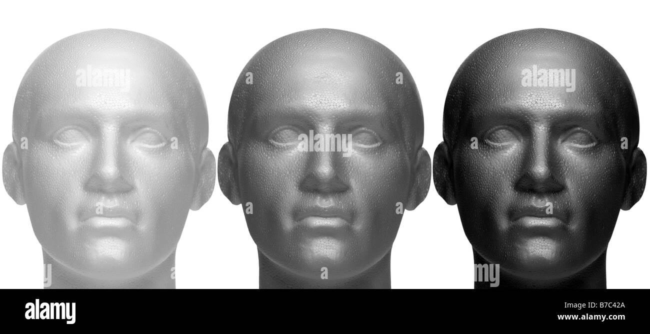 Maniqui tres jefes en color blanco, negro y gris aislado sobre un fondo blanco. Imagen De Stock