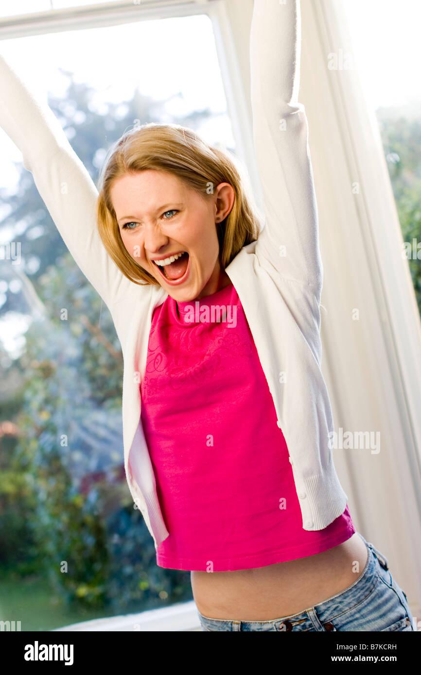 Mujer celebrando Imagen De Stock