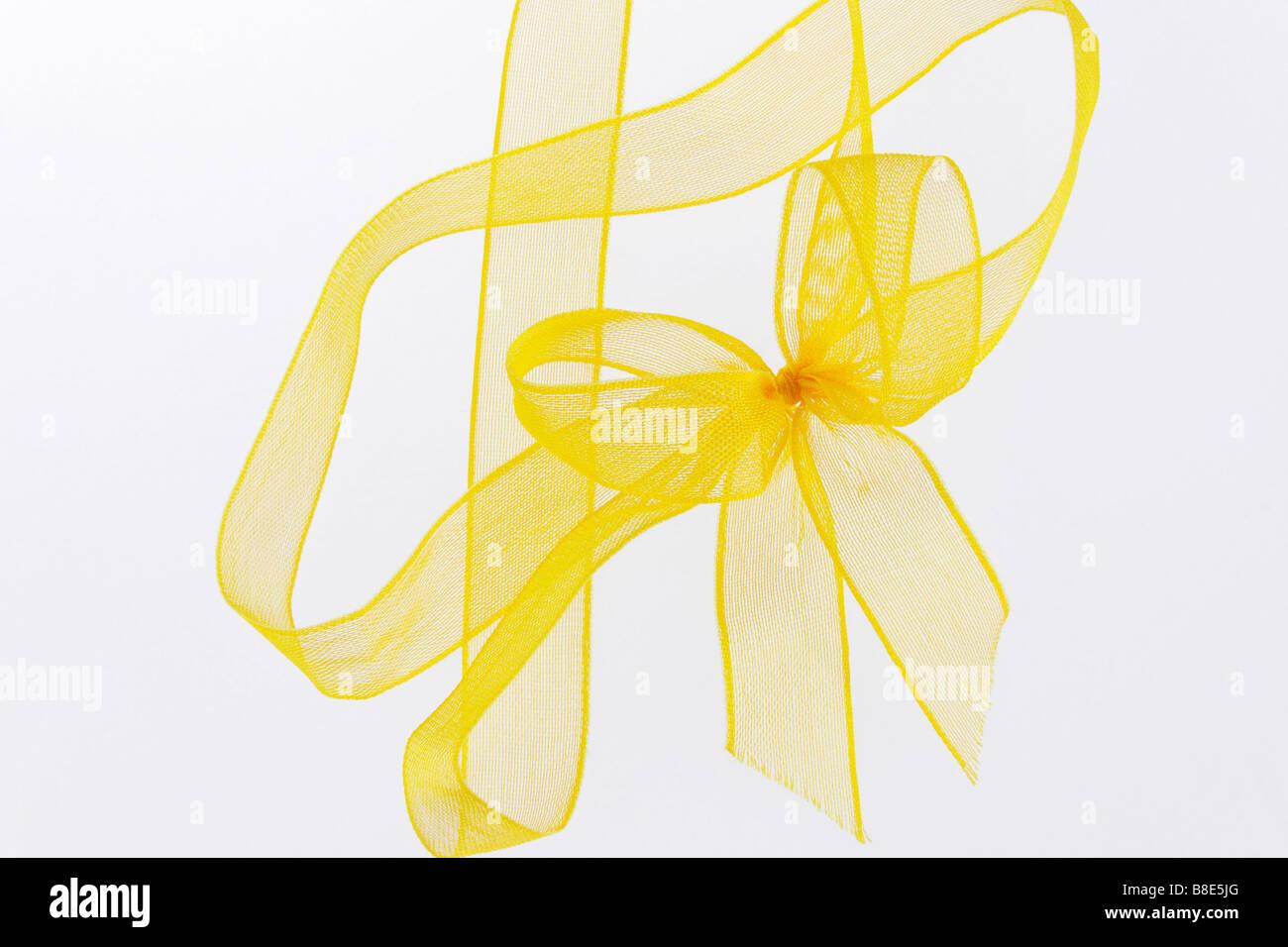 Imagen del clip y de arco de cinta amarilla Imagen De Stock
