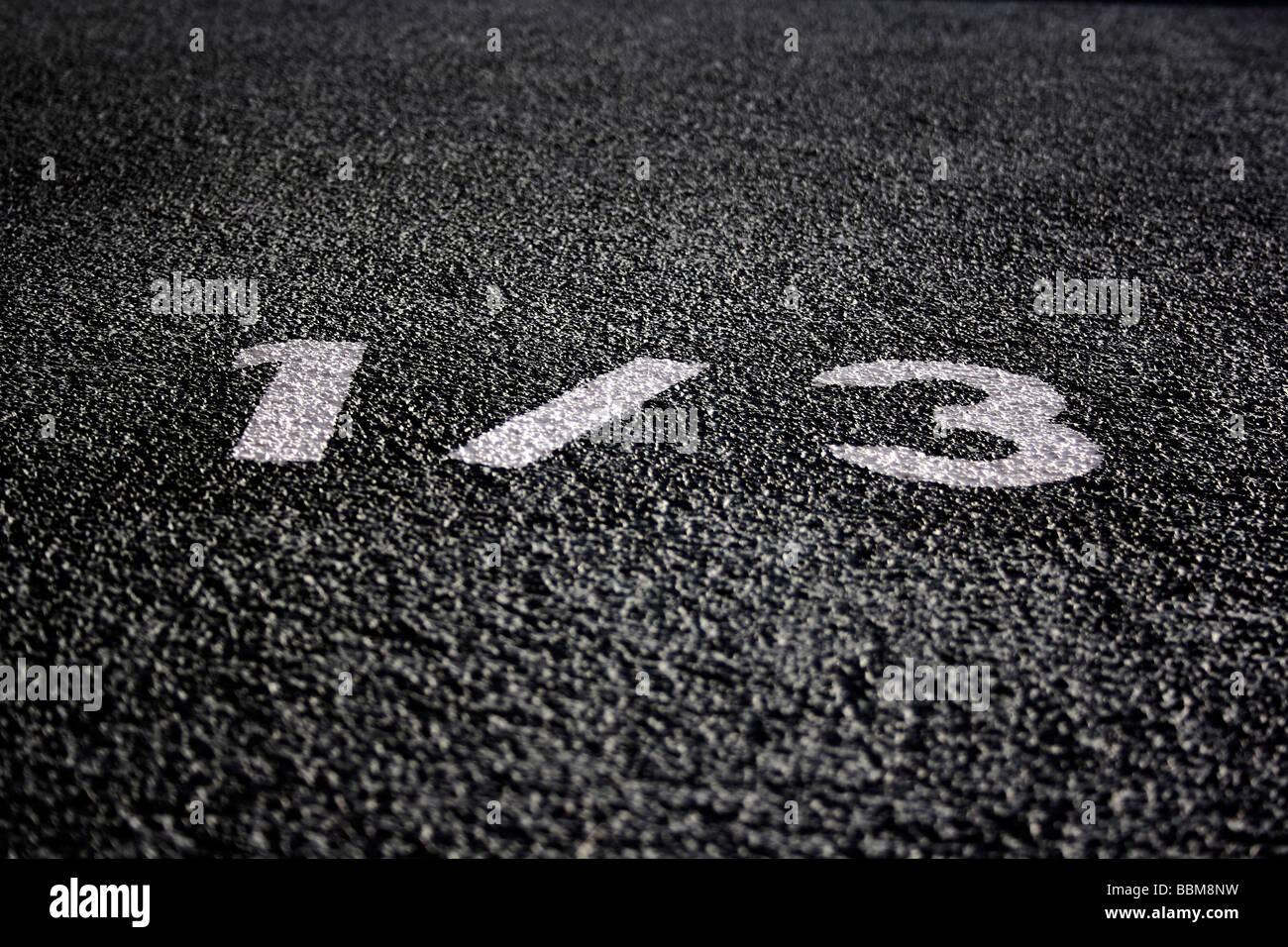 Número de casa 1 / 3 en la pared de la casa Imagen De Stock