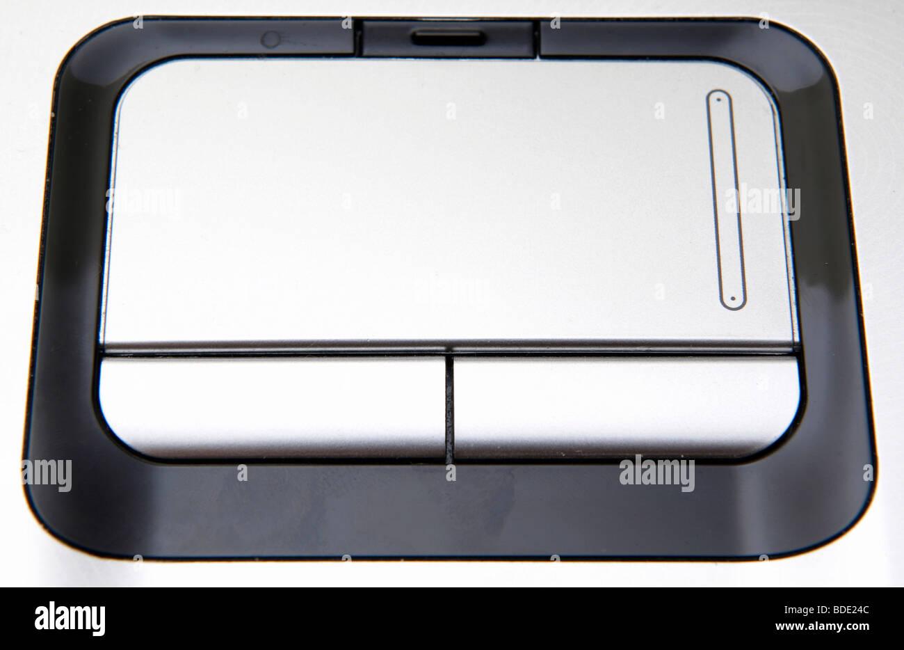Plata vista cercana del touchpad del portátil Imagen De Stock