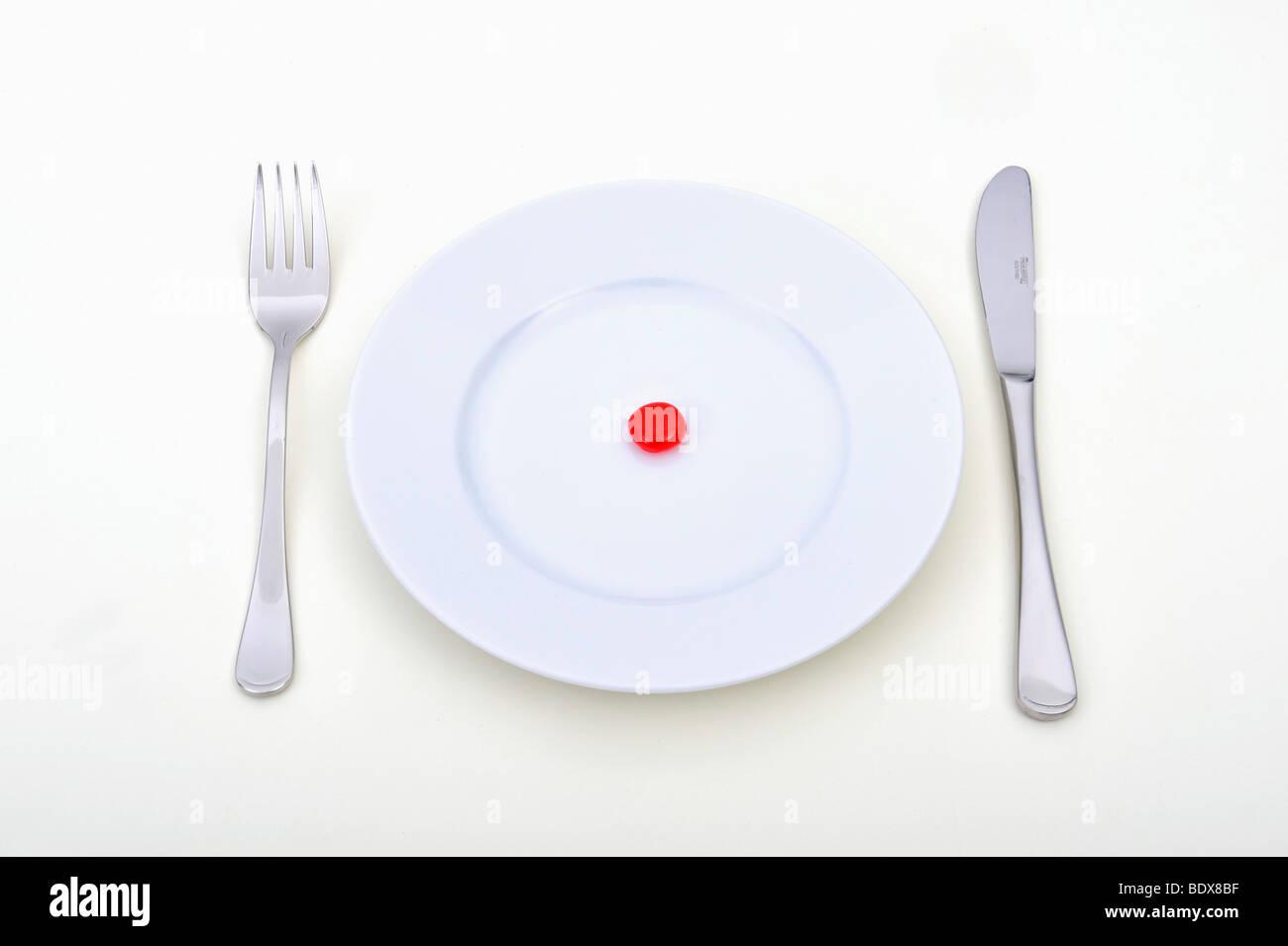 Imagen simbólica para consumo de alimentos sintéticos, la píldora, el uso indebido de drogas, la Imagen De Stock
