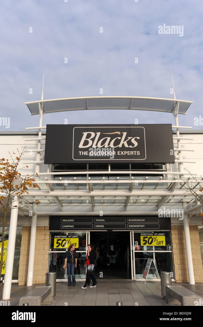 Los negros y el logotipo de tienda exterior signo Inglaterra Imagen De Stock