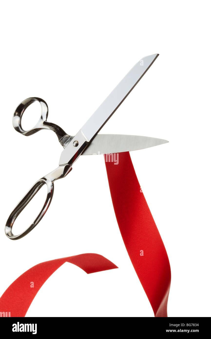 Tijeras de plata cortando la cinta roja simbolizando Brexit Imagen De Stock