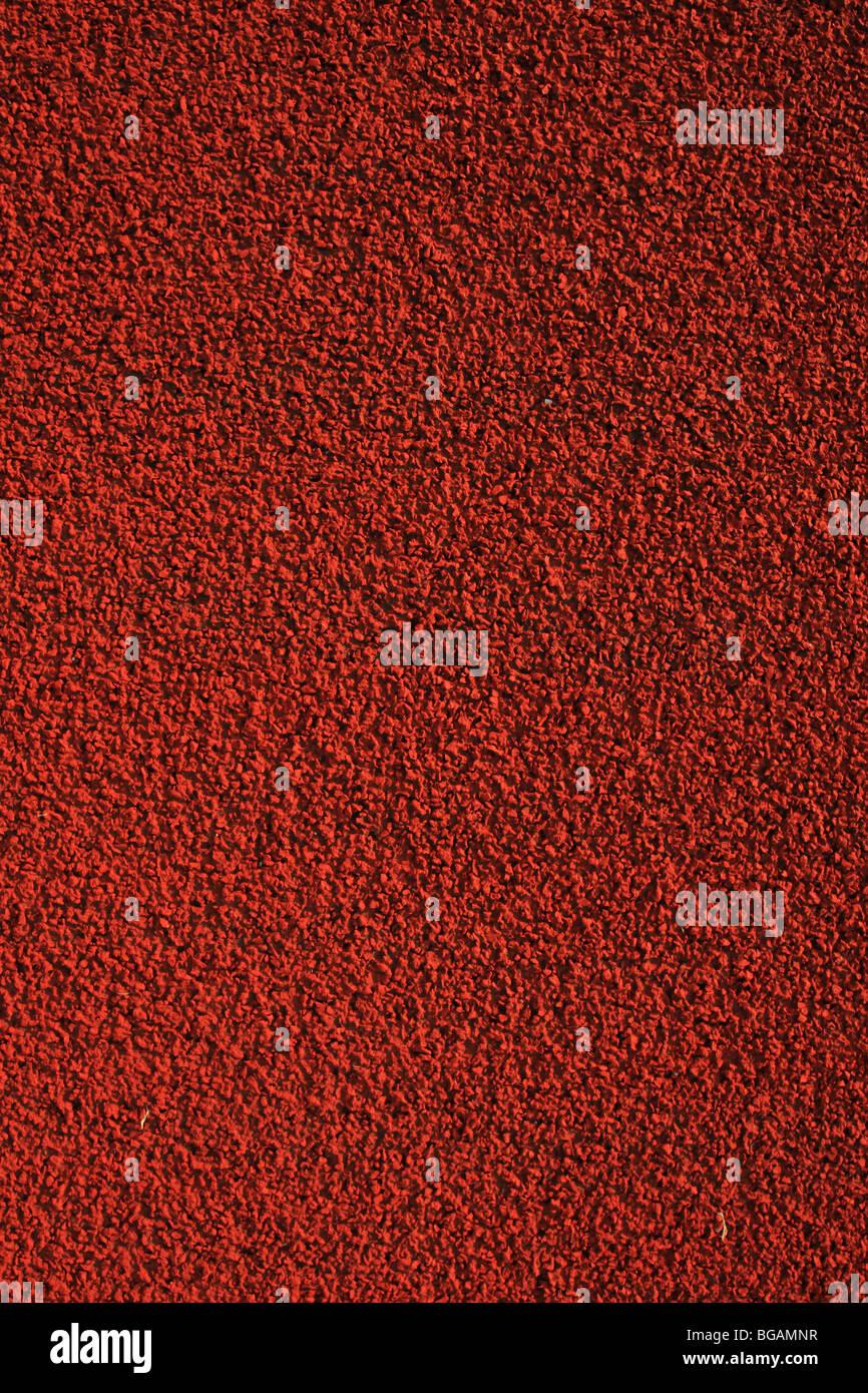 Primer plano de una soleada pista de atletismo gran textura, detallado y gran Antecedentes Imagen De Stock