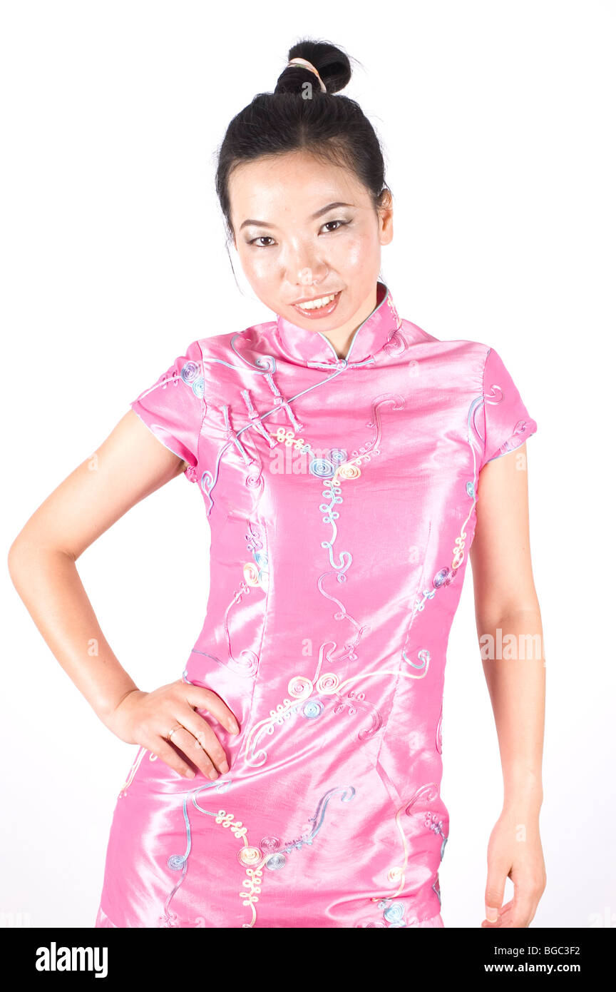 Niña China, Asia belleza, vistiendo vestido rosado Foto & Imagen De ...