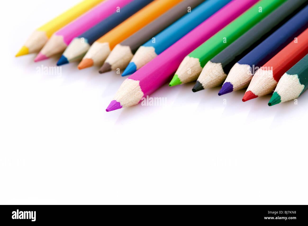 Ganador o metáfora de éxito con lápices de colores Imagen De Stock