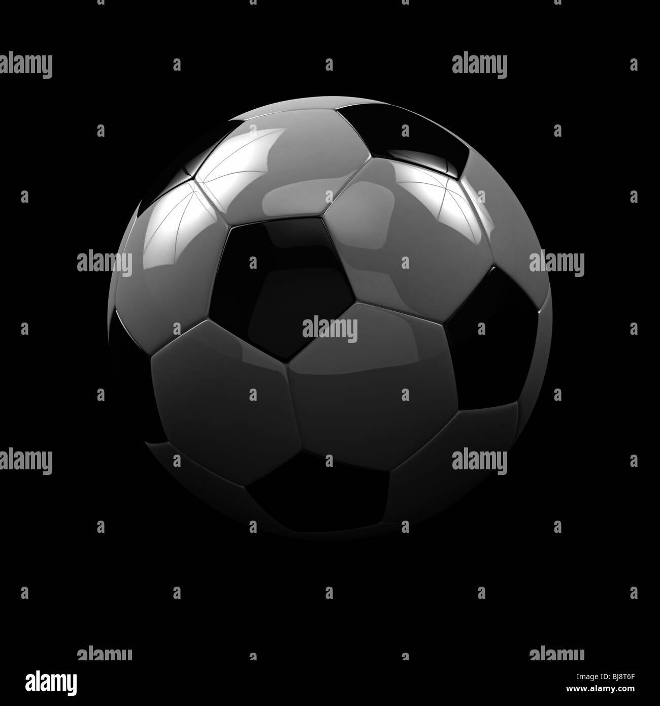 Balón de fútbol sobre fondo negro Imagen De Stock