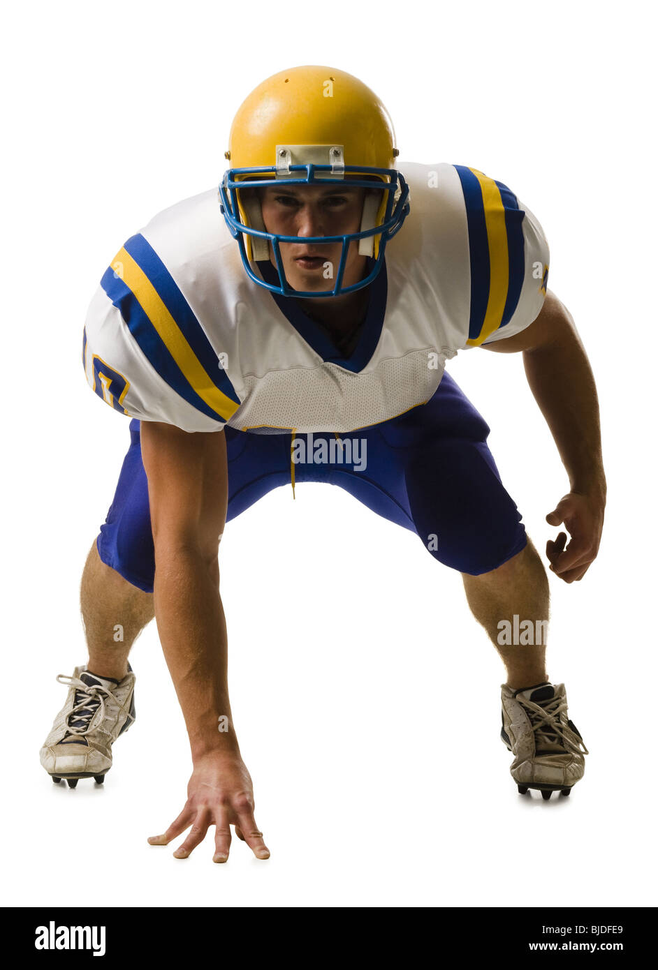 Macho joven jugador de fútbol americano. Imagen De Stock