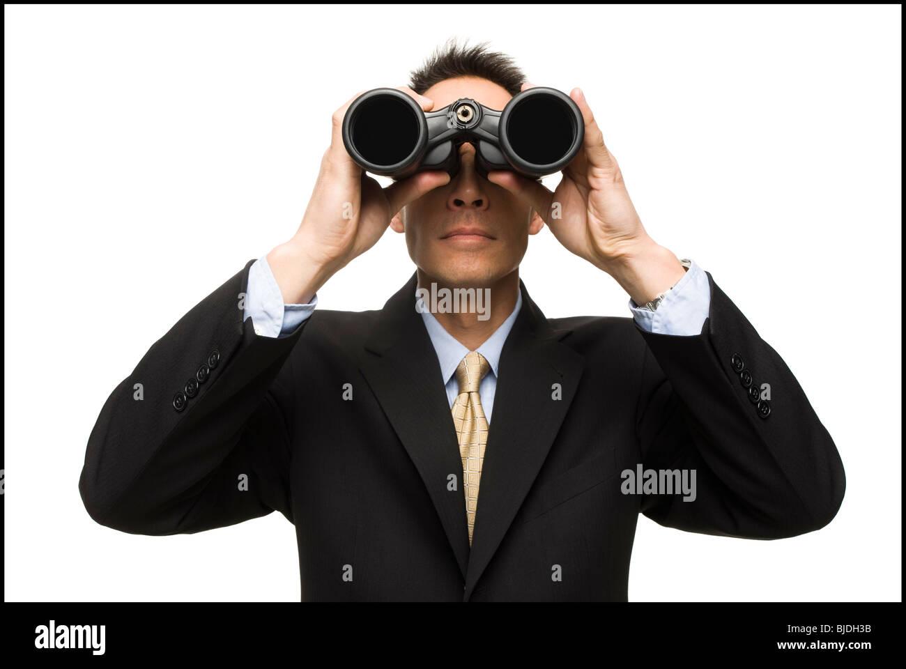 Empresario con prismáticos Imagen De Stock