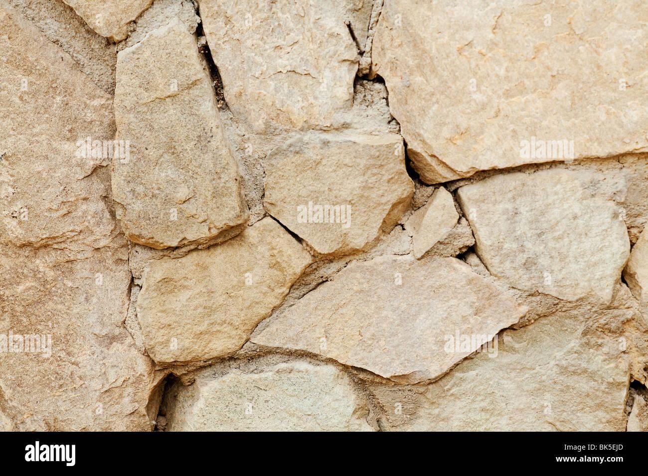Muro de piedra rodada de fondo con una lente macro Imagen De Stock