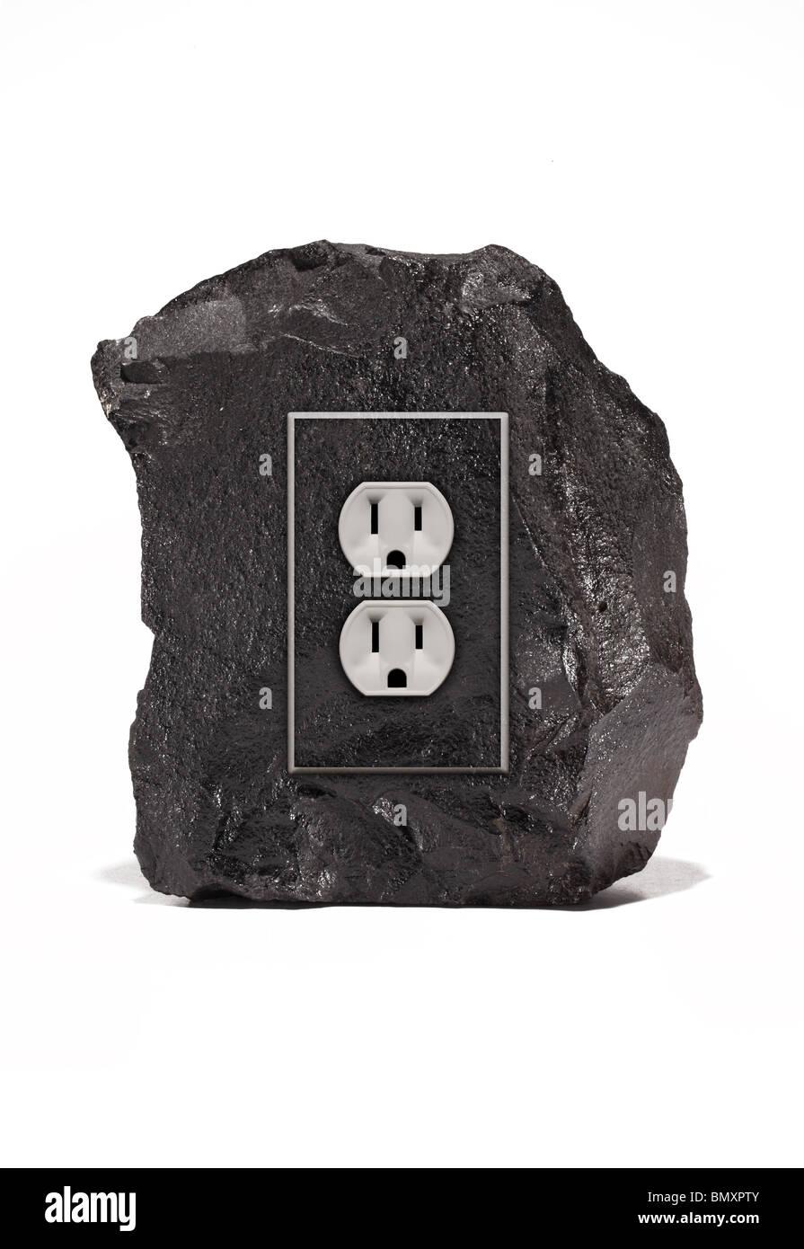 Un gran trozo de negro de carbón con un accesorio de salida de energía eléctrica sobre un fondo blanco. Imagen De Stock
