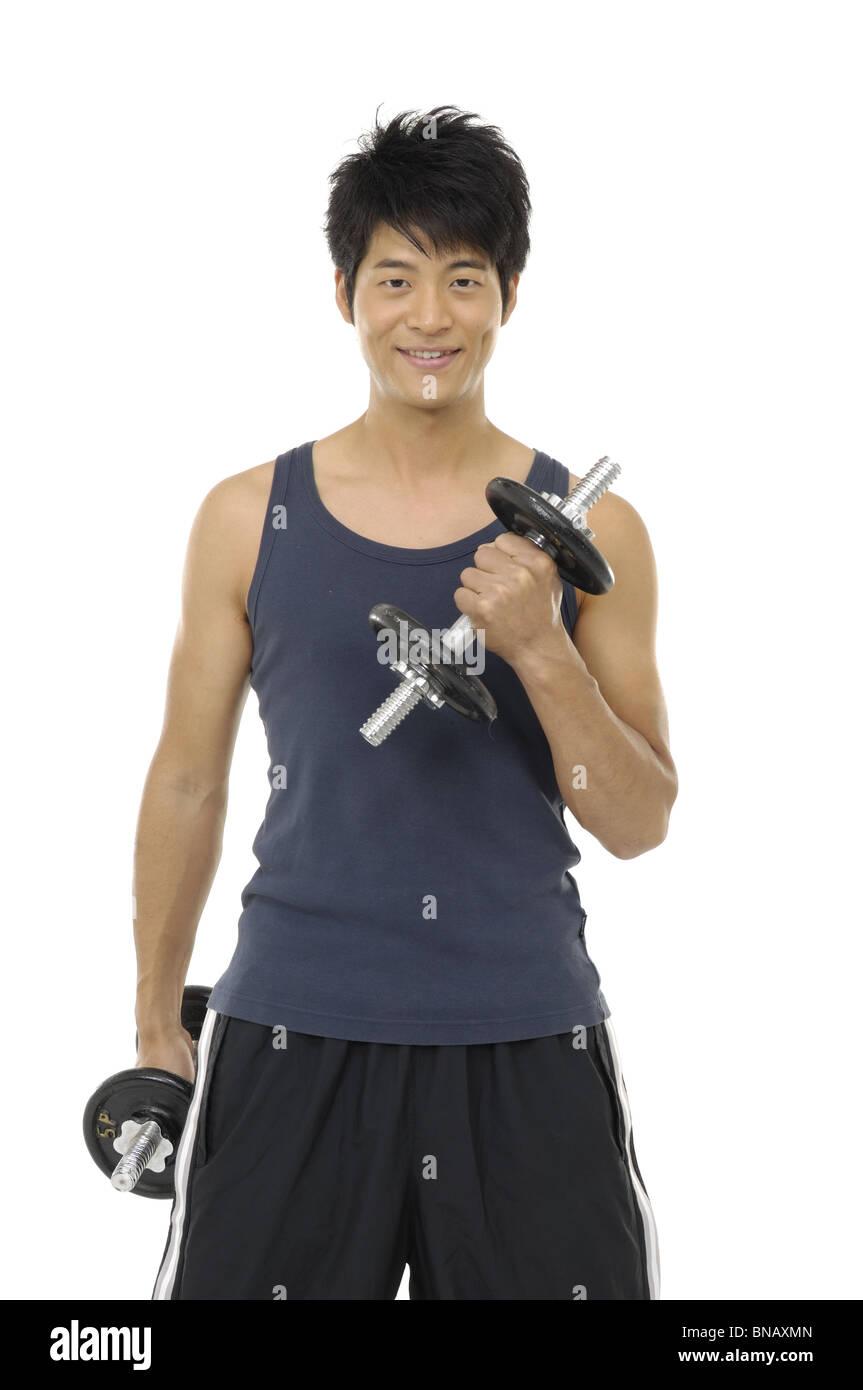 Joven el ejercicio con pesas Imagen De Stock