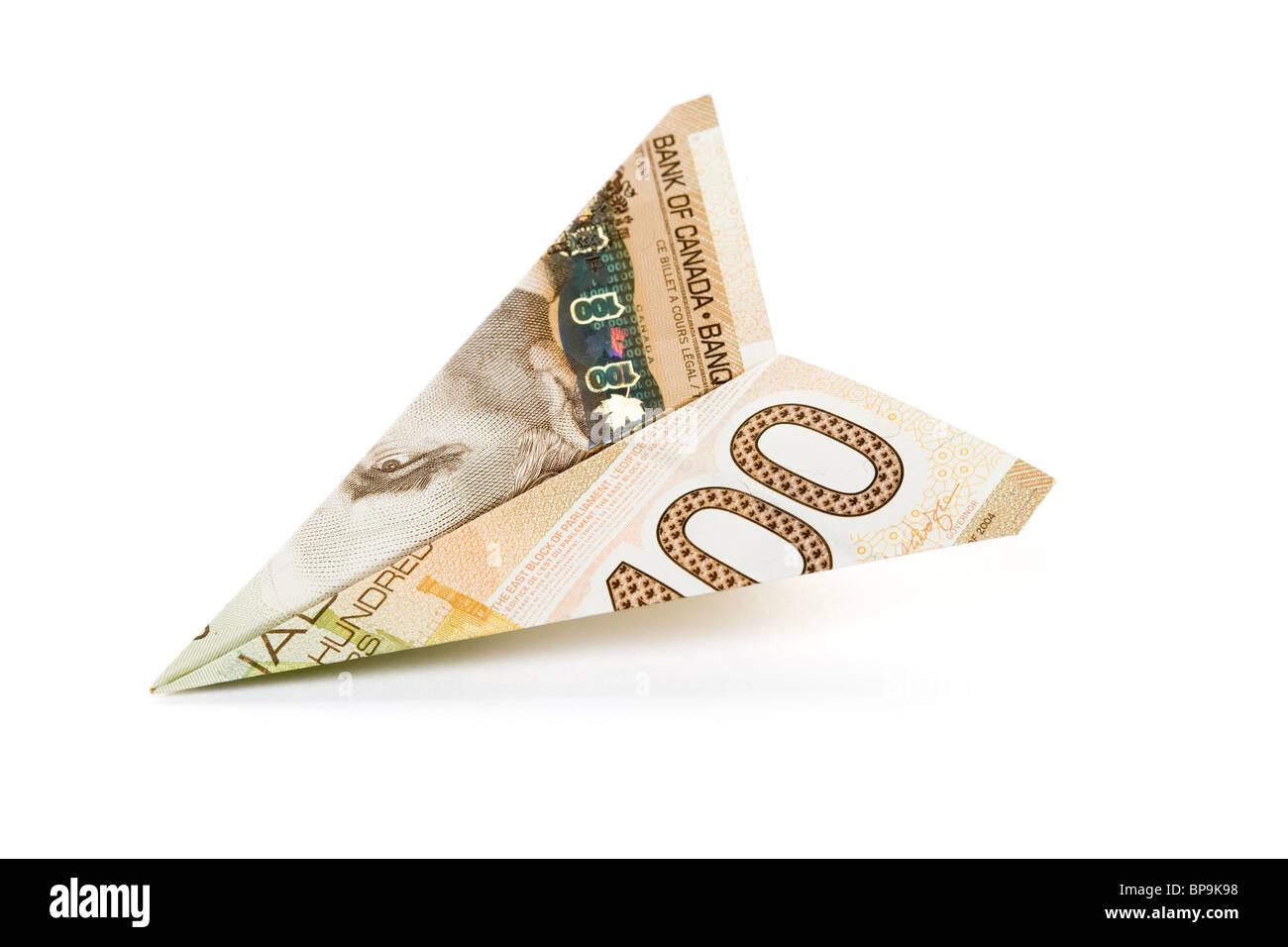 Mano sosteniendo un dólar avión Imagen De Stock