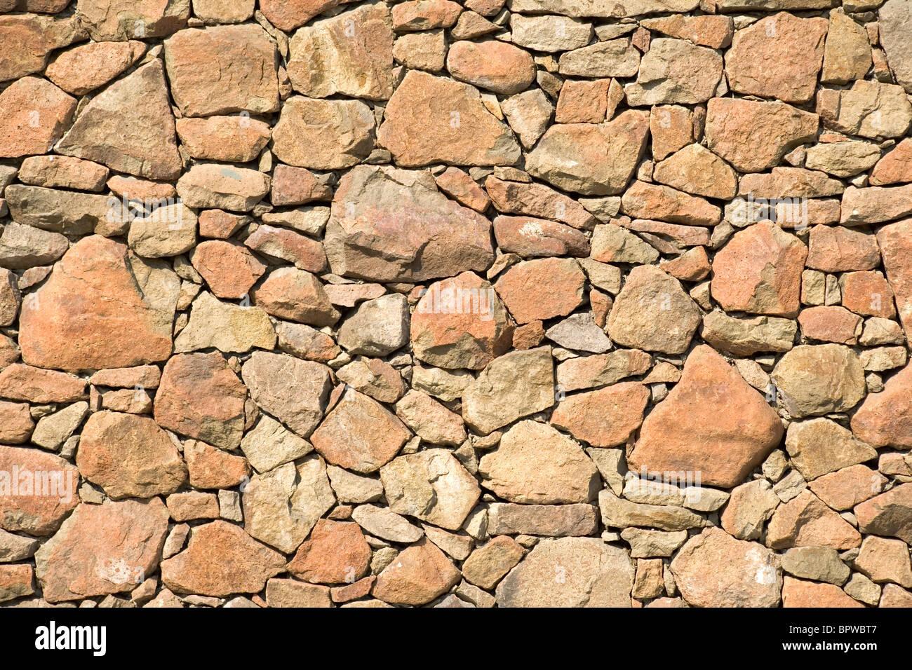Pared de roca amarilla para fondo de patrón Imagen De Stock