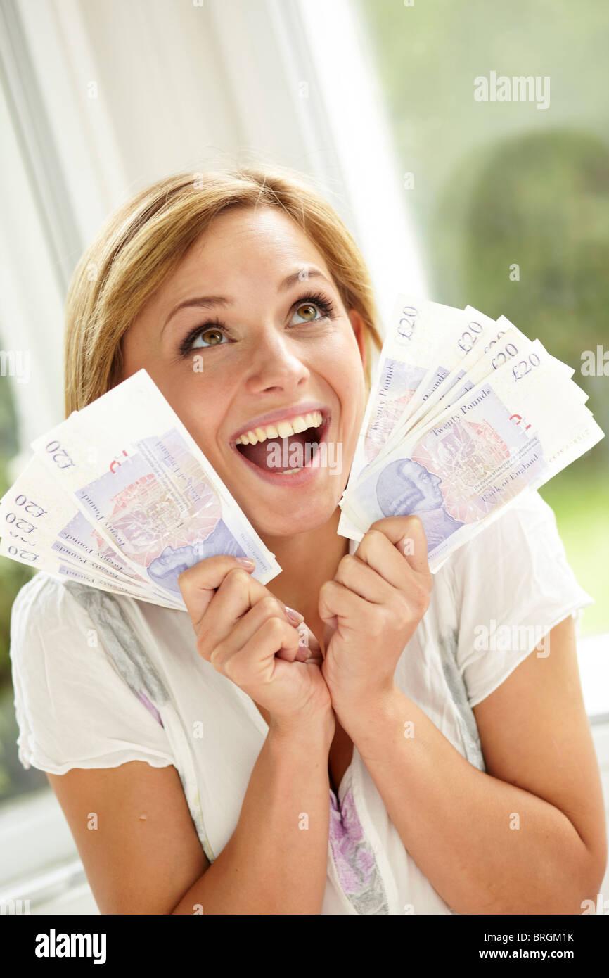 Chica con dinero en efectivo Imagen De Stock