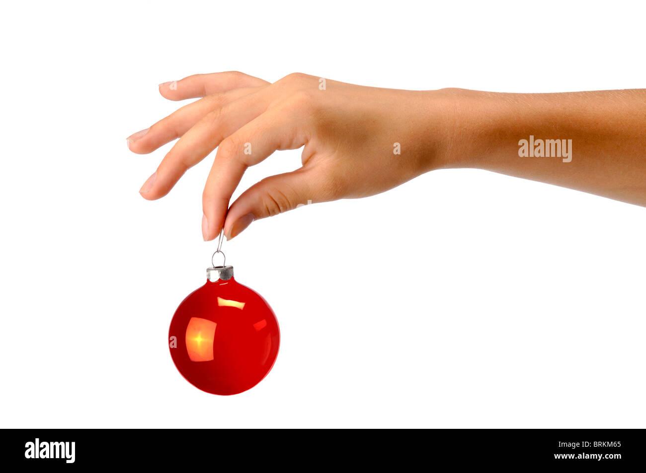Mano sujetando christman ornamento rojo Imagen De Stock