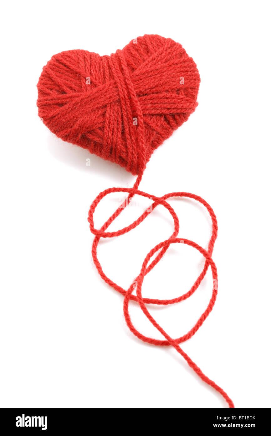Hilados de lana en el símbolo con forma de corazón Imagen De Stock