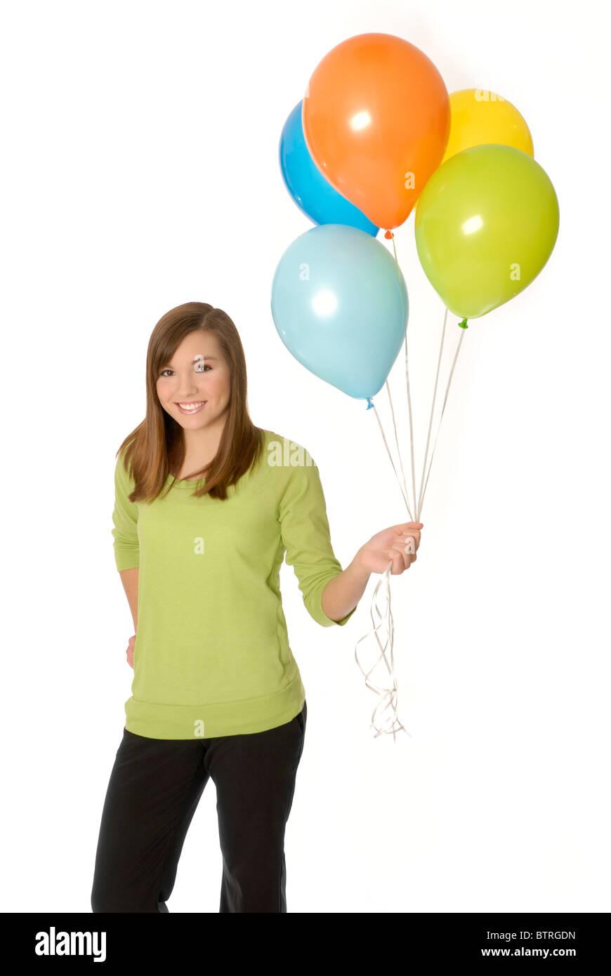 Adolescente sosteniendo globos. Imagen De Stock