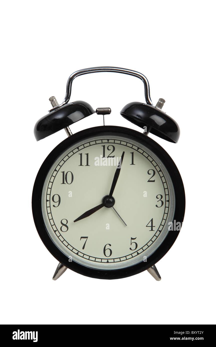 Reloj alarma sobre fondo blanco. Imagen De Stock