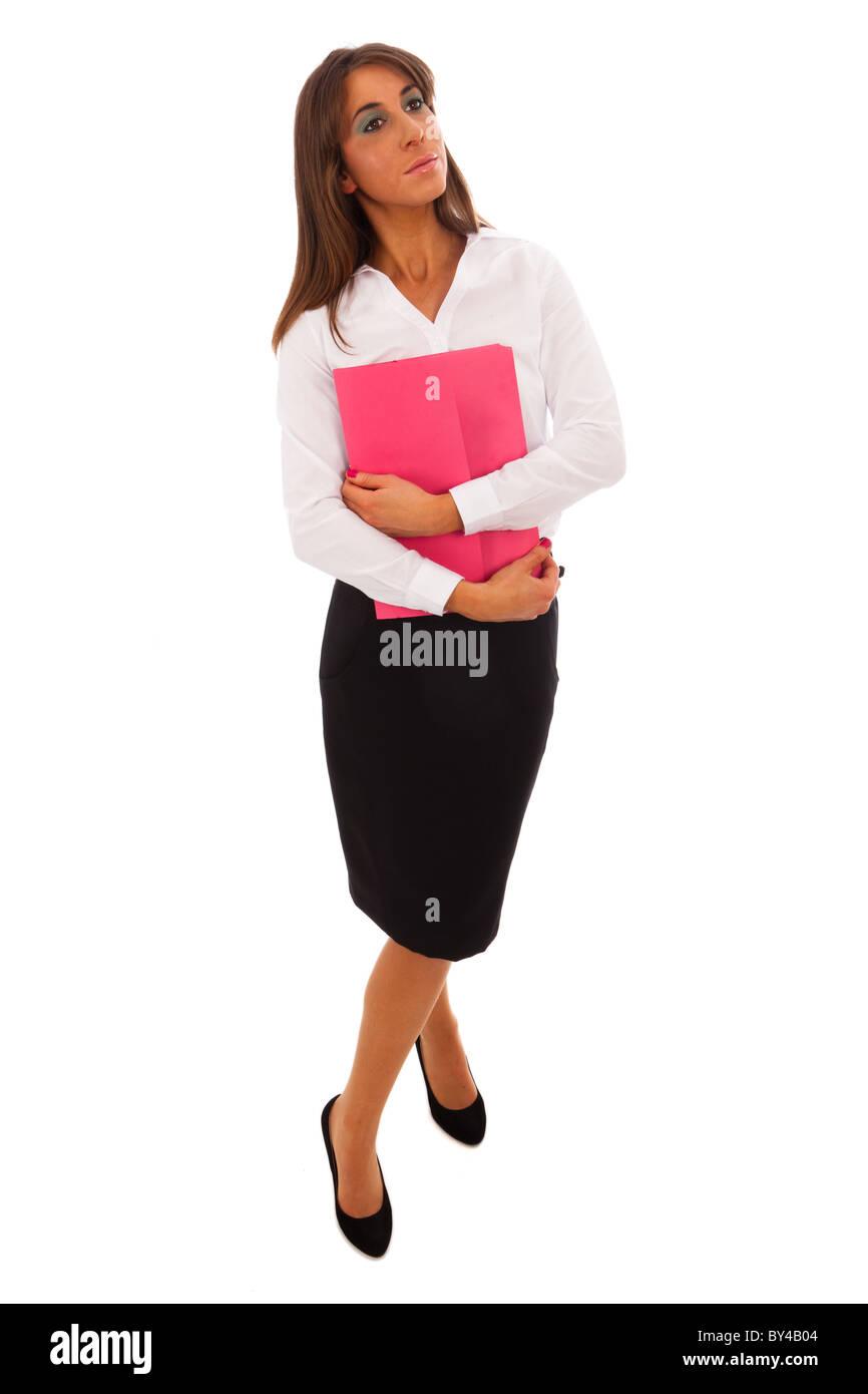 07cbb8509 Mujer de negocios en falda negra y blusa blanca portando una carpeta ...