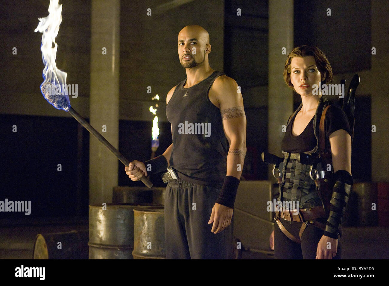 Resident Evil: Afterlife Año : 2010 USA / Director Británico : Paul W.S. Anderson Boris Kodjoe, Milla Imagen De Stock
