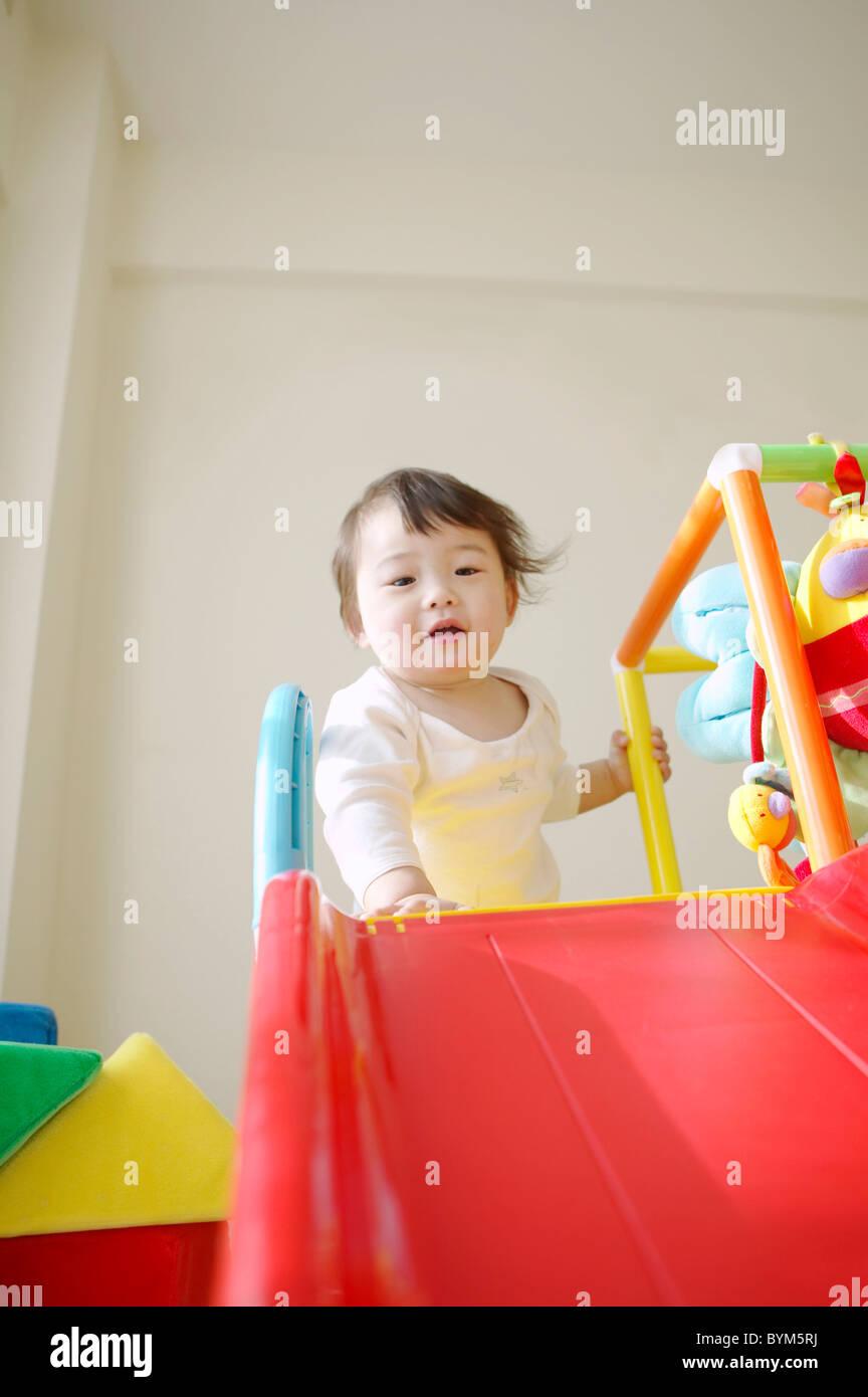Baby Girl por diapositiva Foto de stock