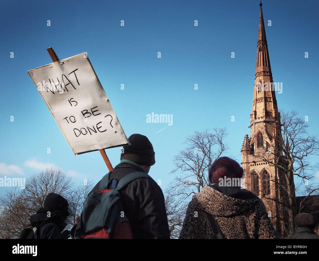 Cámara digital Olympus estudiantes protestando contra la matrícula aumenta con banner a través de Imagen De Stock