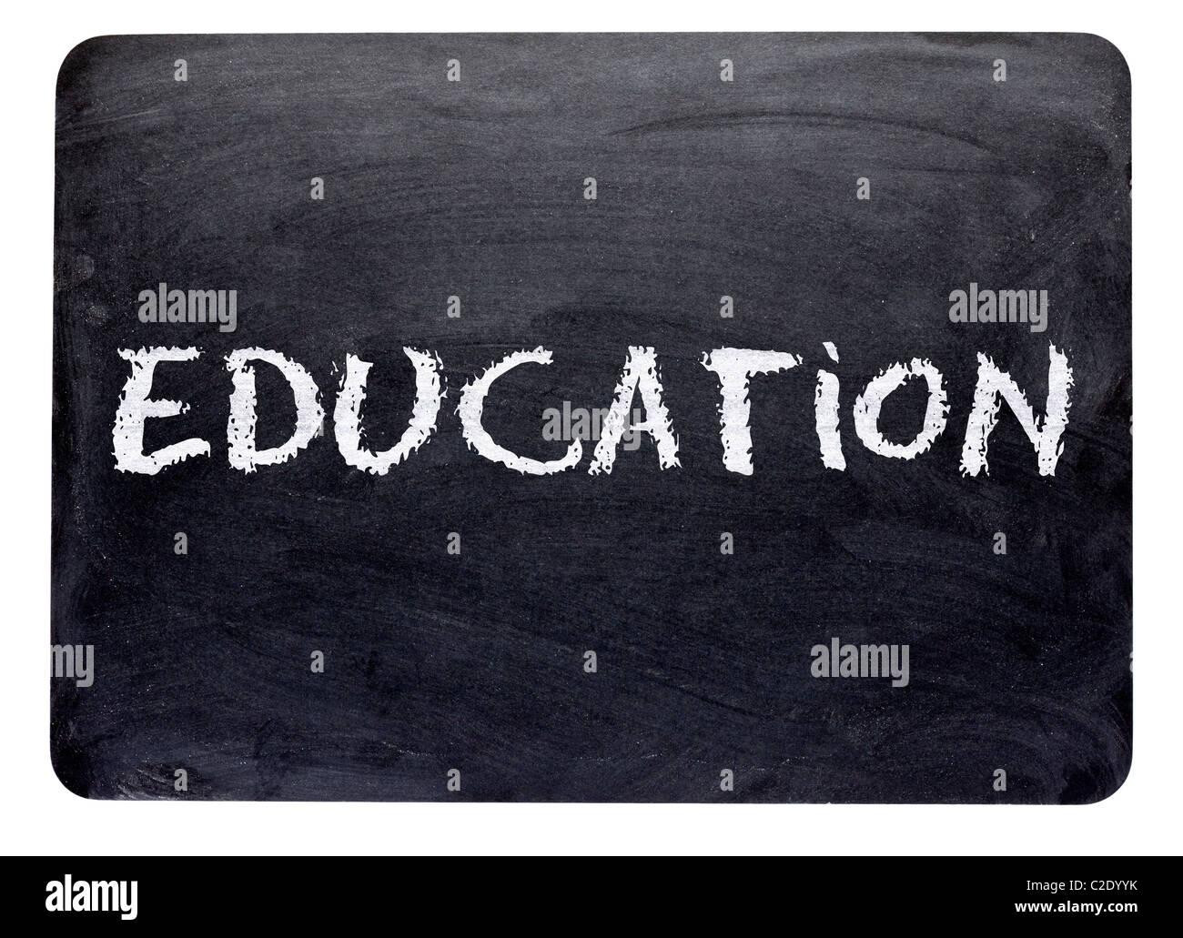 La educación, la palabra escrita en una pizarra de tiza, cerca - educación, el concepto de aprendizaje Imagen De Stock
