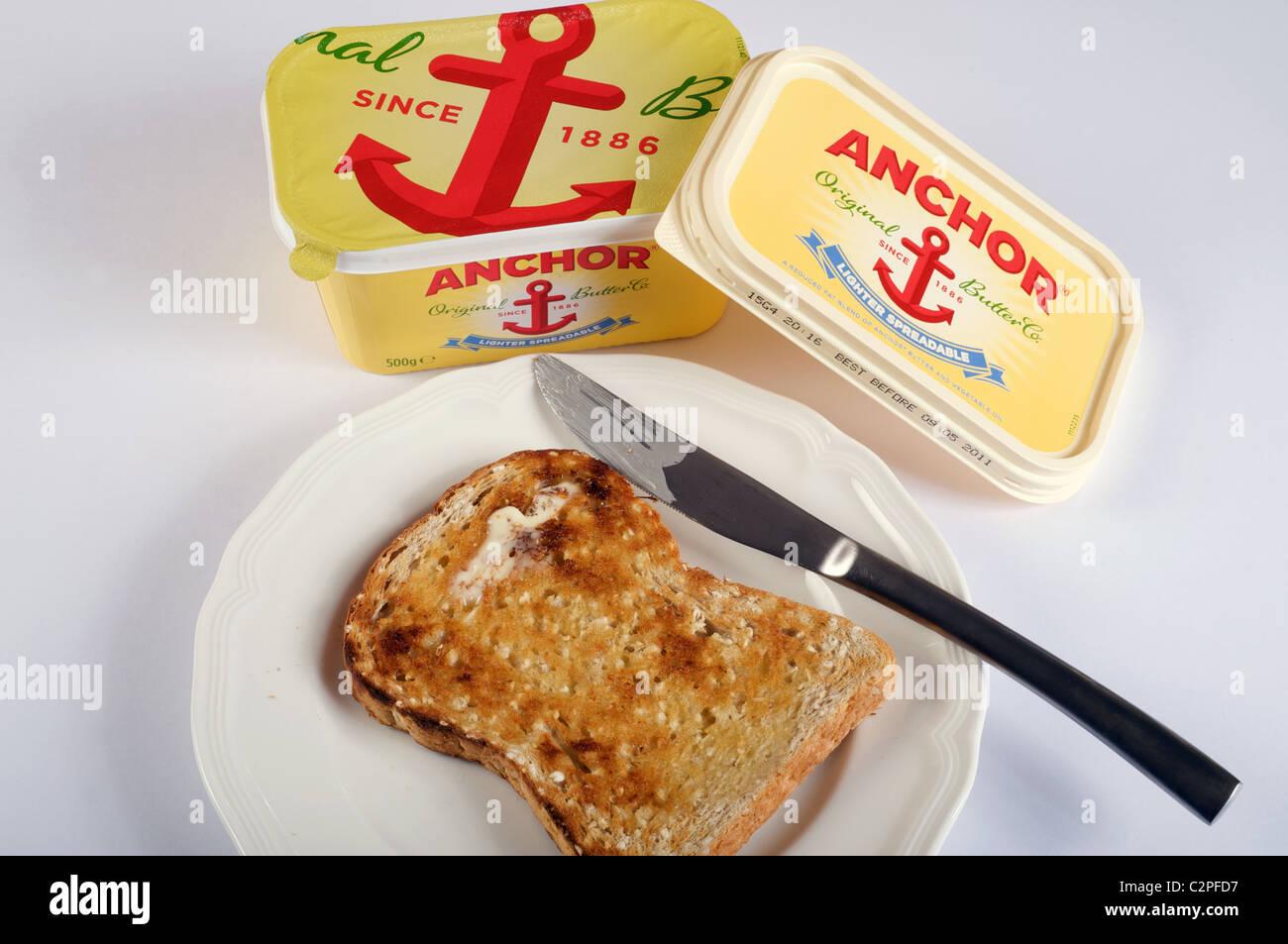 Mantequilla de anclaje y tostadas Imagen De Stock