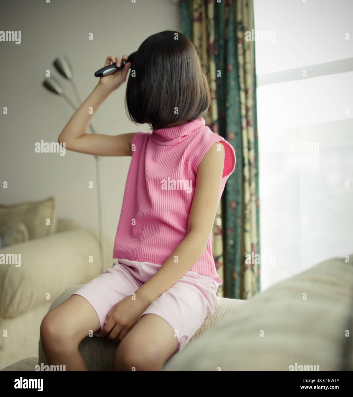Chica pelo cepillado Imagen De Stock