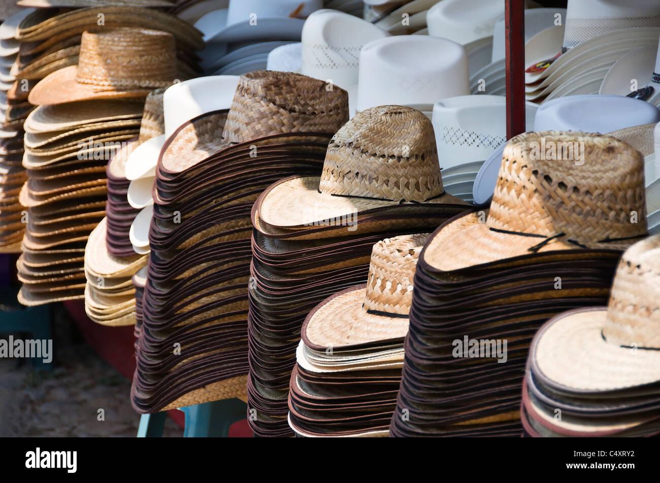 36e57f4b4d2da Una variedad de sombreros se apilan en venta en este mercado al aire libre  se atasque en Talpa de Allende