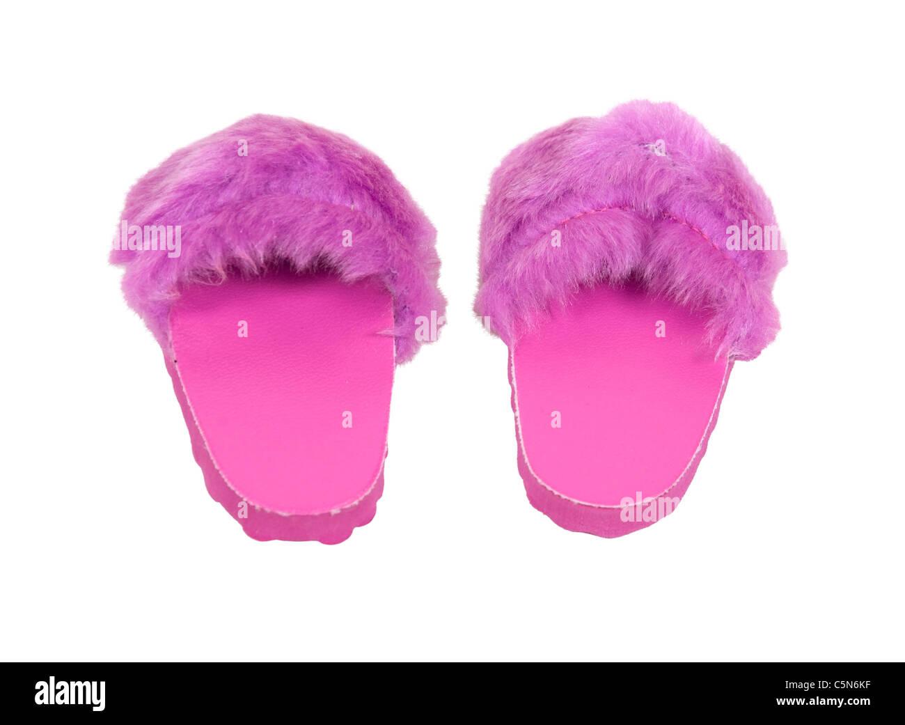 Fuzzy zapatillas rosa listos para llevar a casa cuando relajarse en lujo - Ruta incluida Imagen De Stock