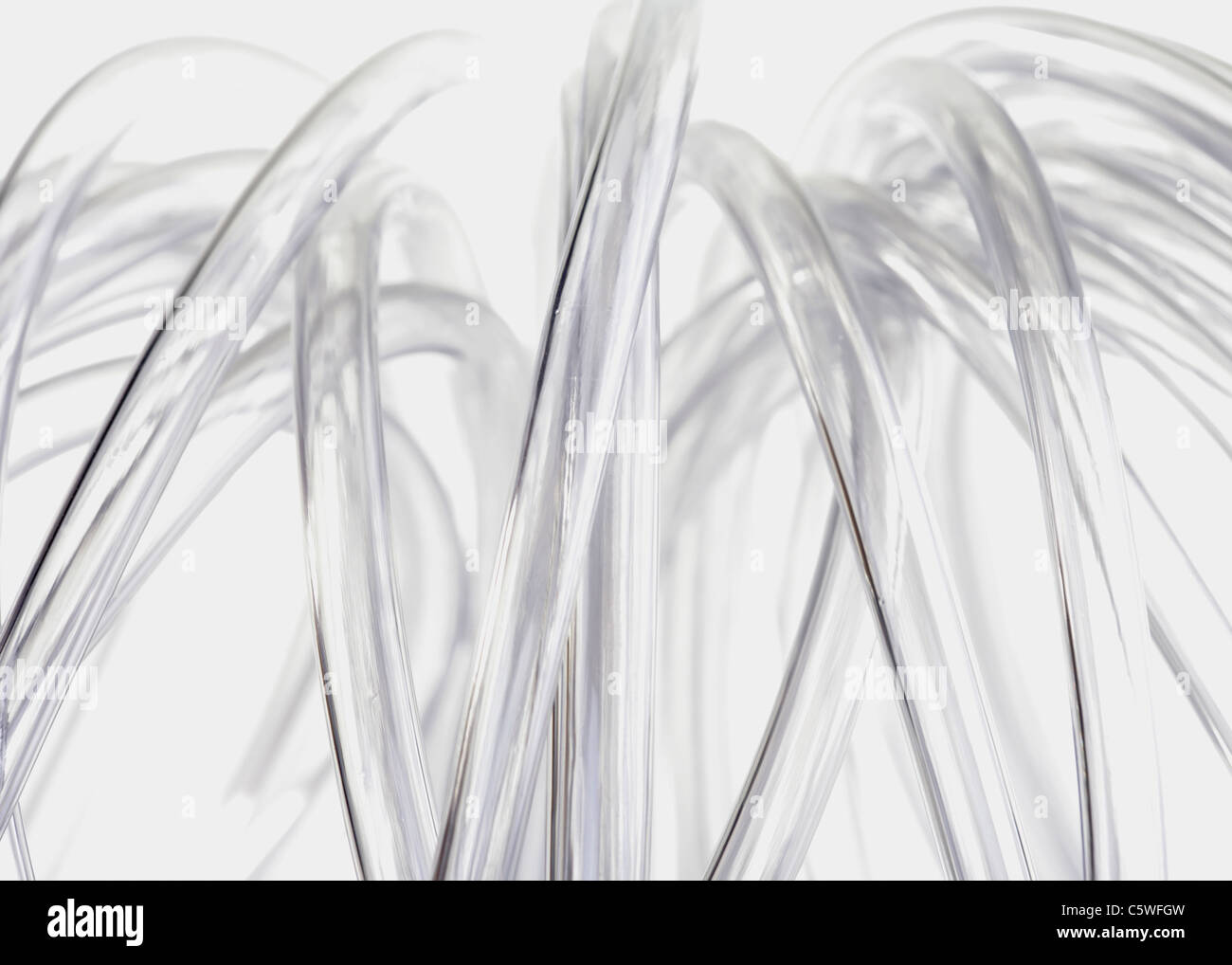 Tubos de plástico contra el fondo blanco. Imagen De Stock