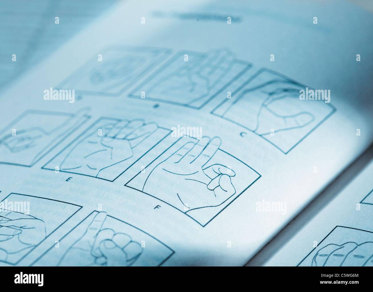 Los lenguajes de signos en el folleto, cerrar Foto de stock
