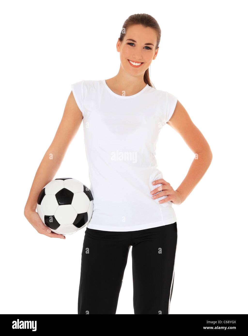 00a22d2a080dd Atractiva mujer joven en ropa deportiva sosteniendo un balón de fútbol. Todo  sobre fondo blanco.