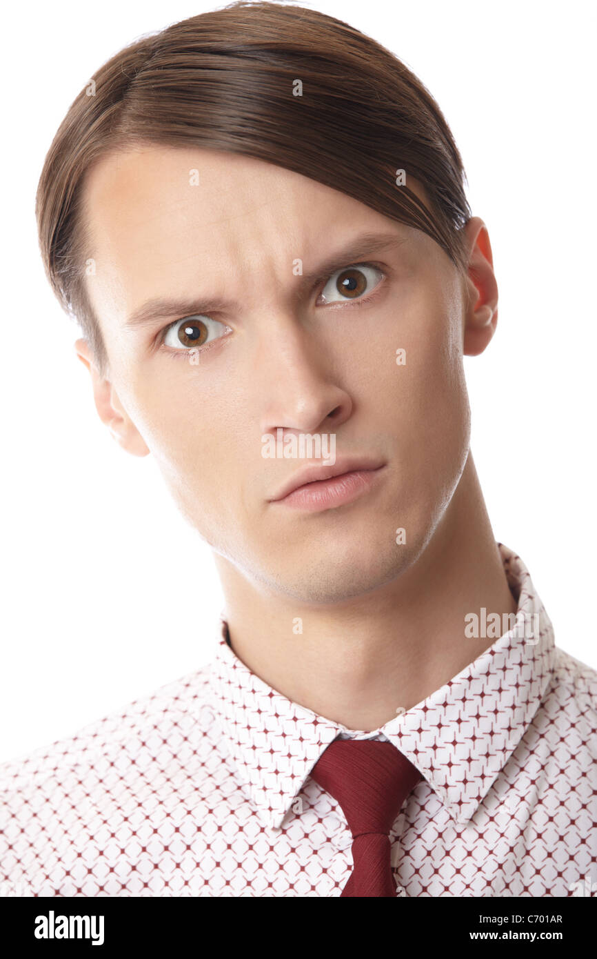 Hombre serio con corbata sobre un fondo blanco. Imagen De Stock