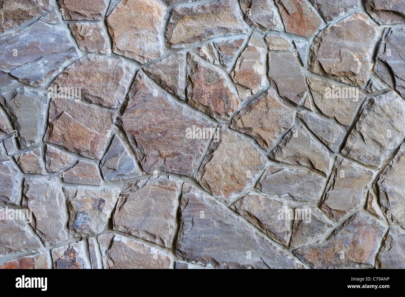 La textura de los antiguos muros de piedra como fondo Imagen De Stock