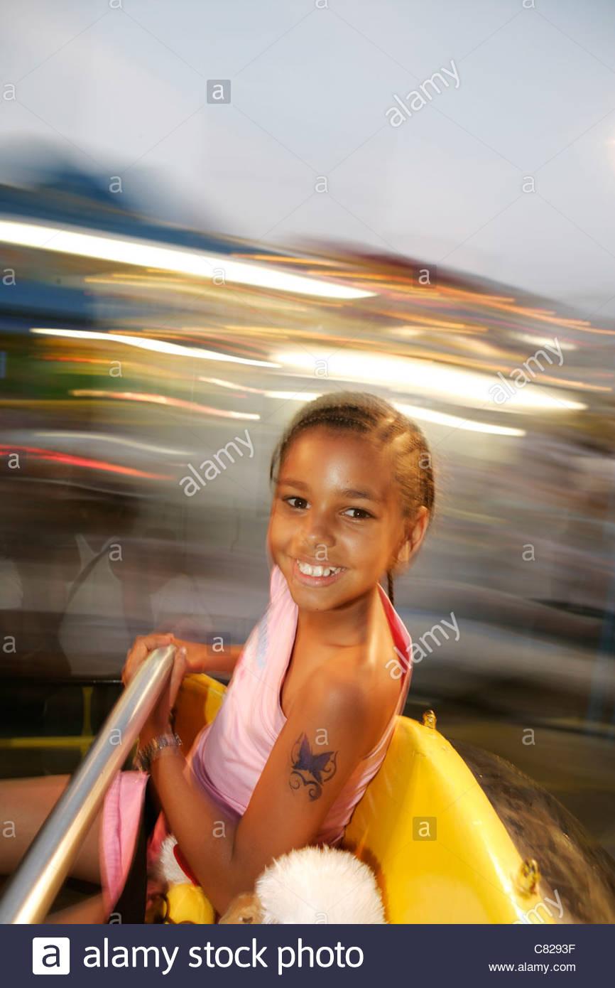 Los Estados Unidos, Nueva York, en Coney Island, parque de atracciones en la chica de carrusel Imagen De Stock