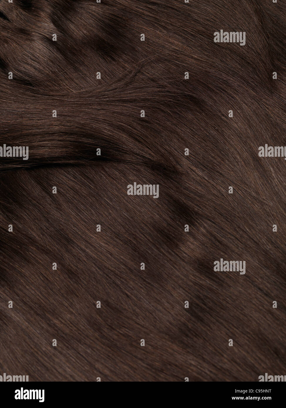 Extensiones de cabello natural humano marrón textura de fondo Imagen De Stock