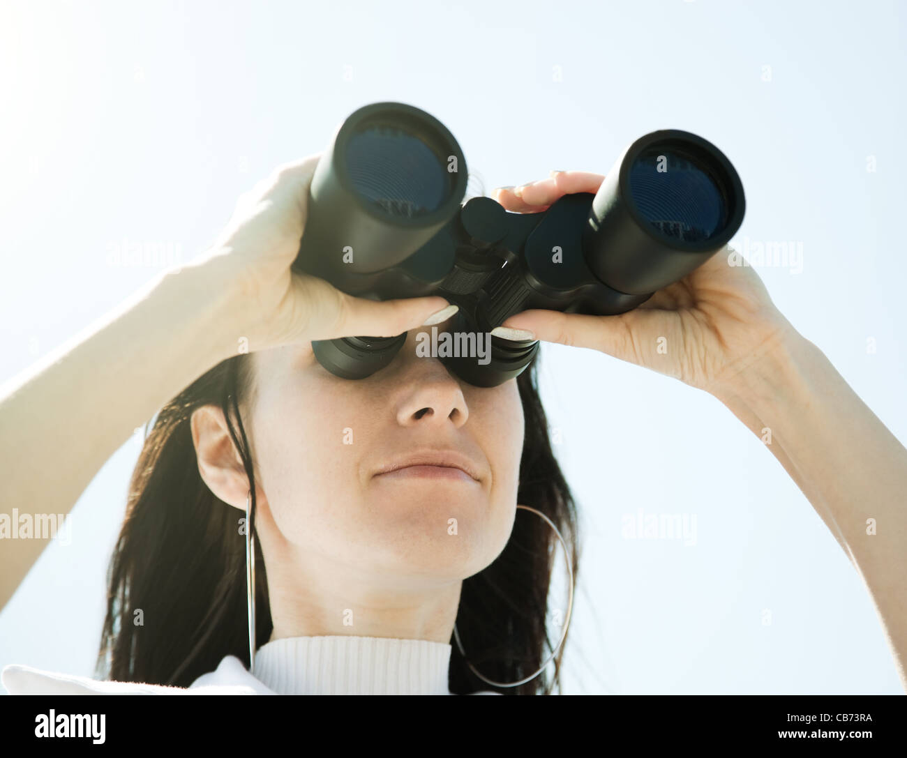 Chica con prismáticos Imagen De Stock