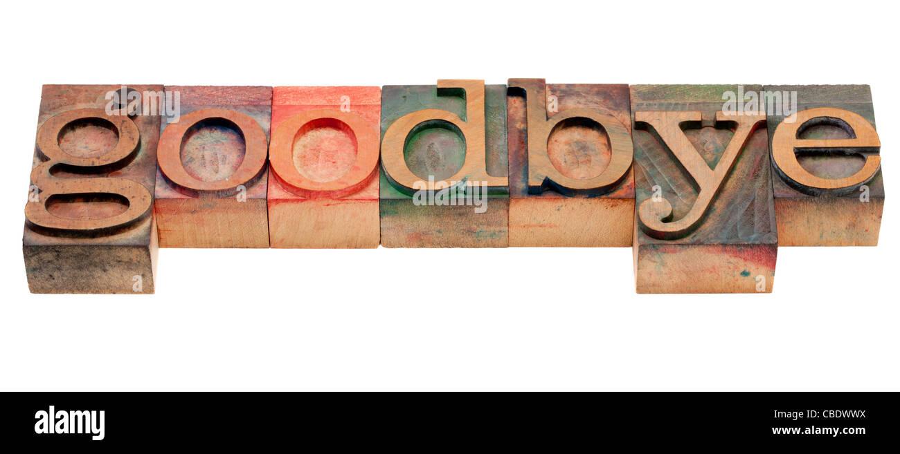 Adiós o despedida concepto - palabra aislada en vintage tipografía, bloques de madera manchada por las Imagen De Stock