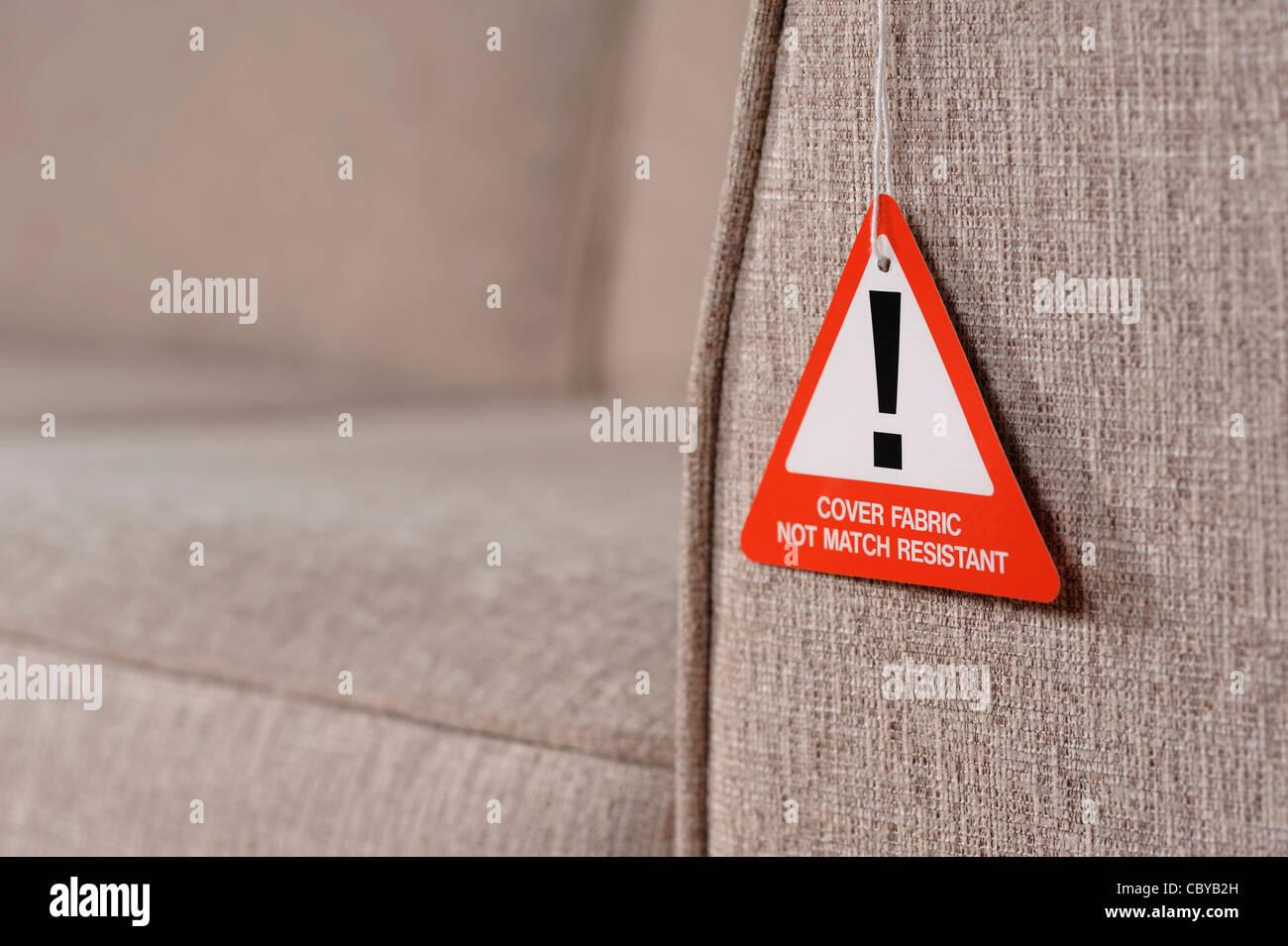 Sofá de la etiqueta de advertencia de seguridad contra incendios Imagen De Stock