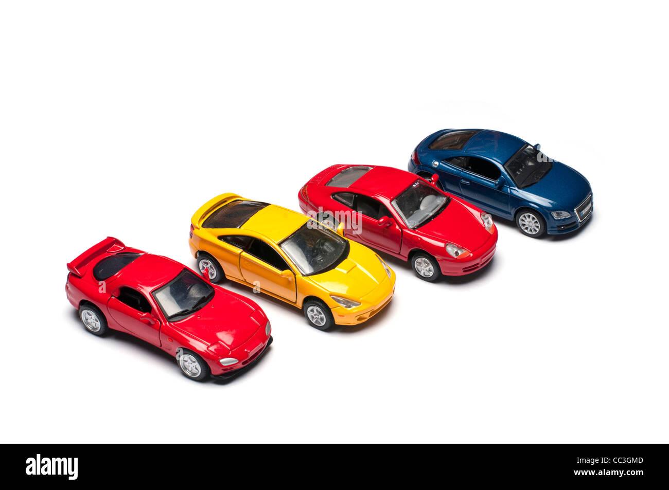 Cuatro coches deportivos de juguete Imagen De Stock