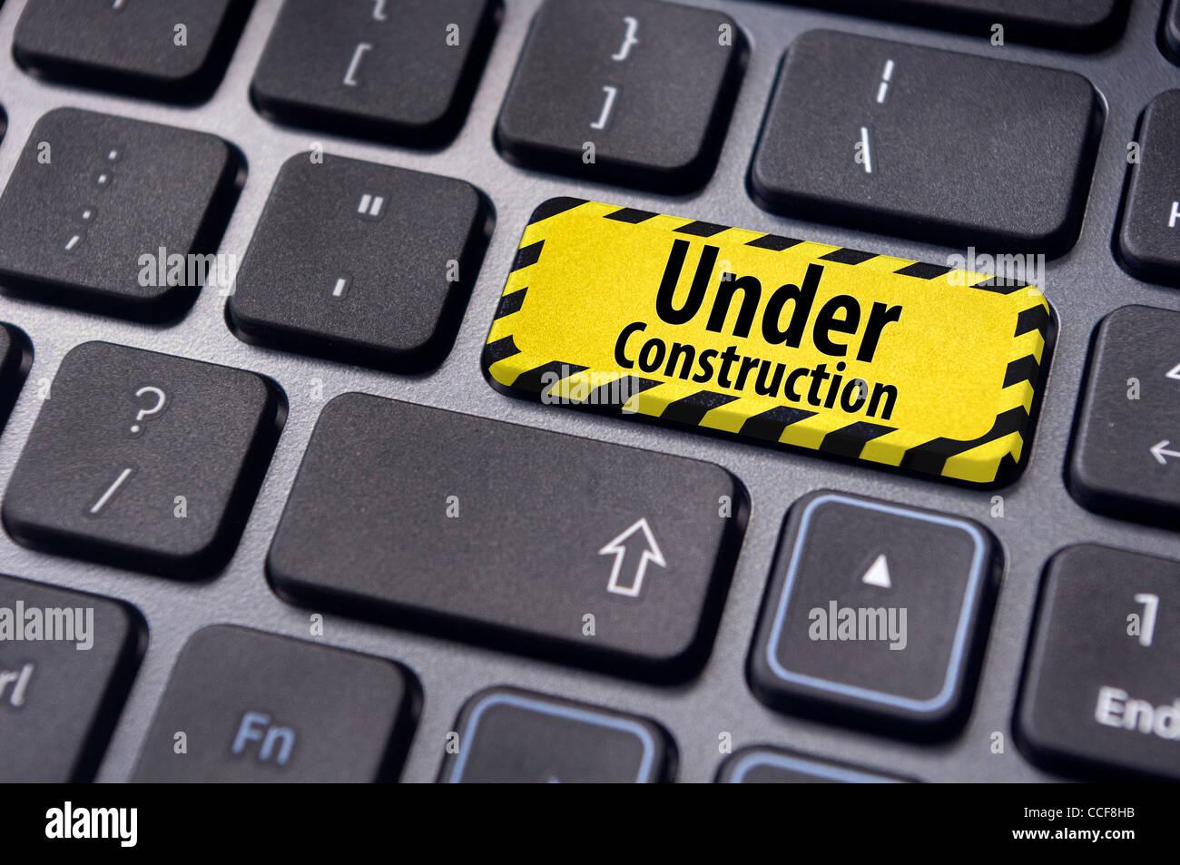 Mensaje en construcción en la tecla Intro del teclado para el sitio ...