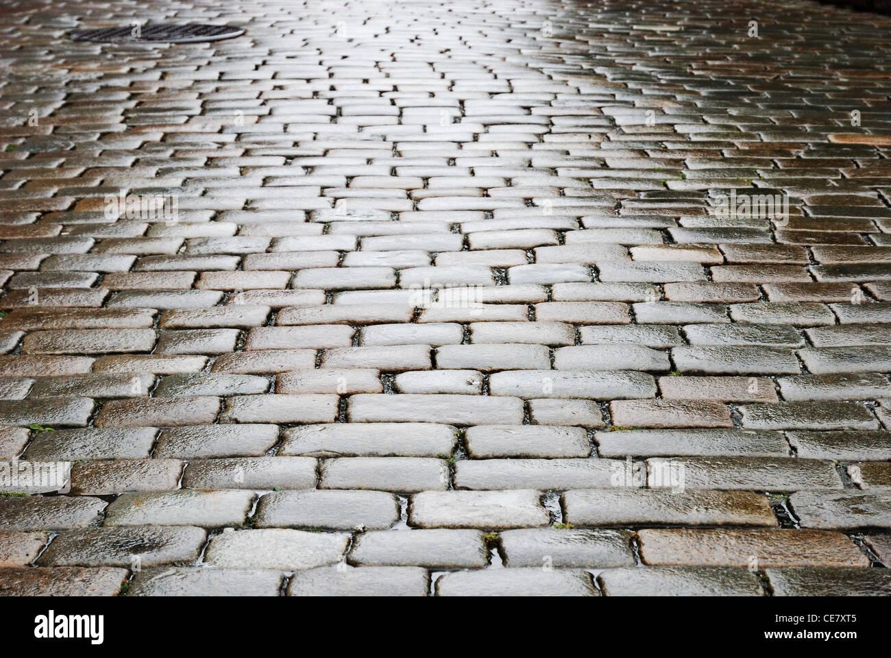 Bloque húmedo-piedras de sett pavimentación Foto de stock