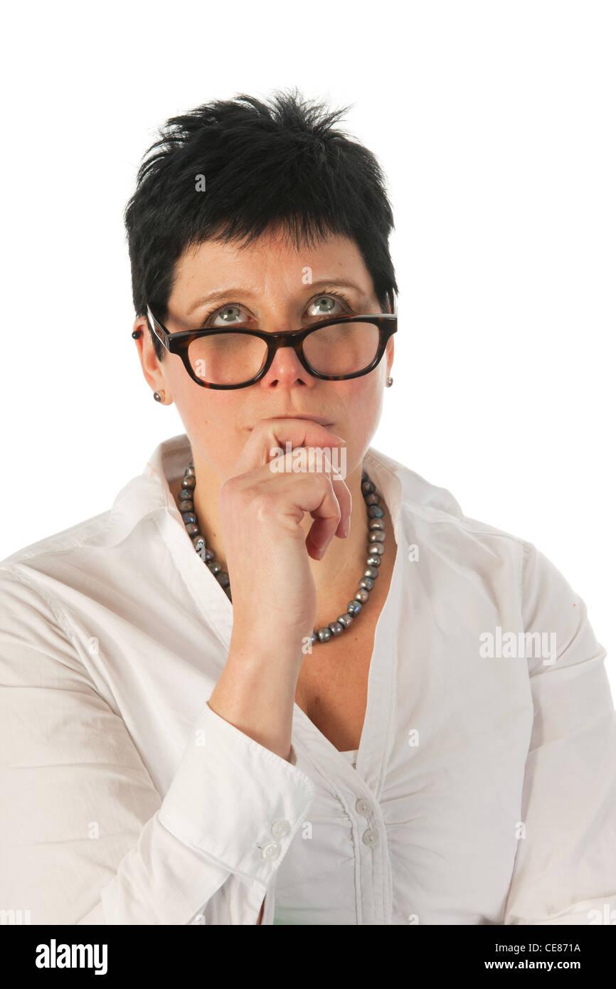 Mujer joven pensando en algo Imagen De Stock
